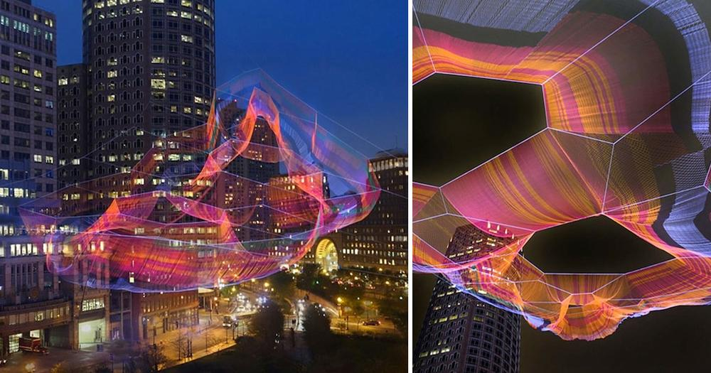 A Monumental Sculpture of Colorful Twine Netting Suspended Above Boston