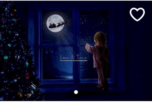 Santa flying over the via jen