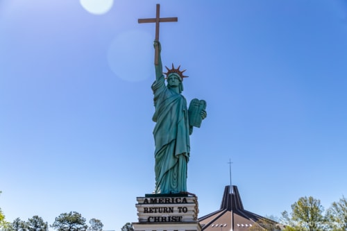 Lady Liberty with a Cross via Liam Douglas - Professional Photographer