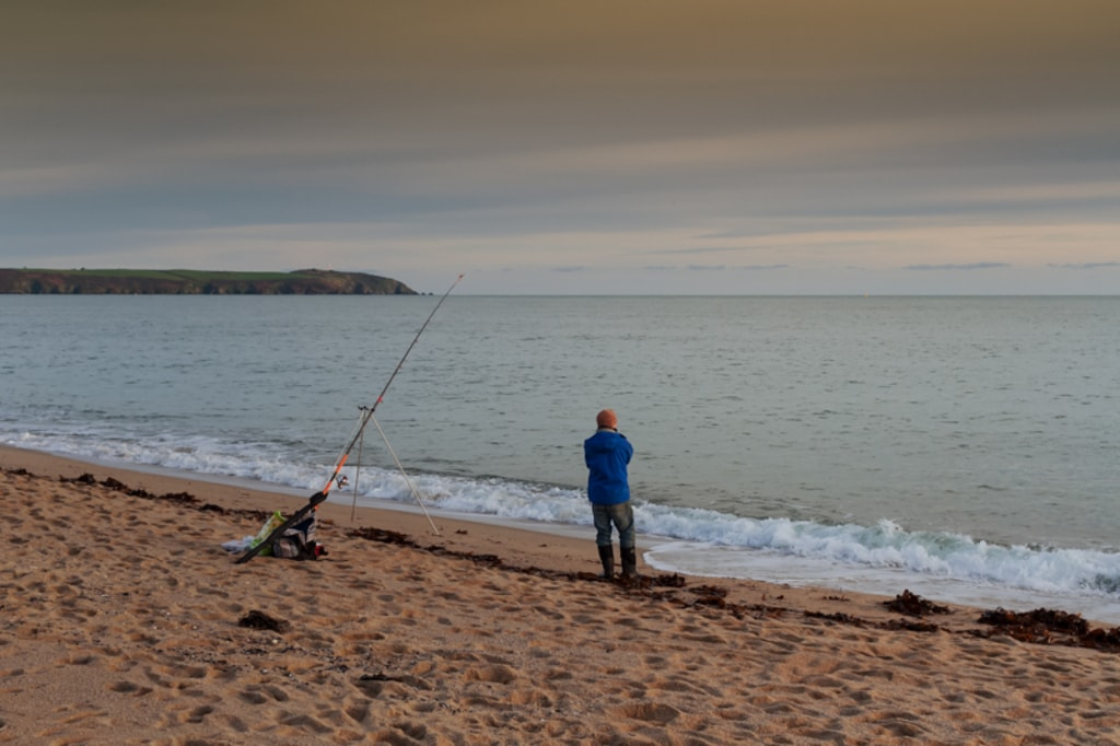 A lonely fisherman is looking at the sea during sunset in St... via Jukka Heinovirta