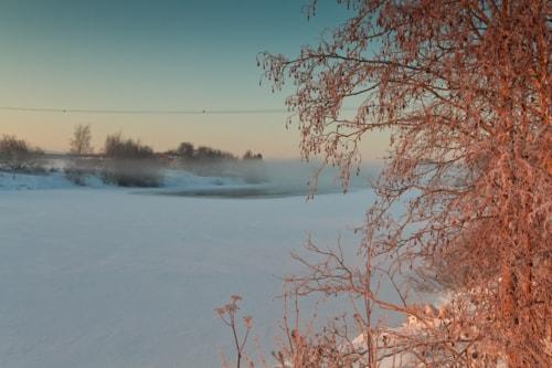The winter sun rises over the icy river at the Northern Finl... via Jukka Heinovirta
