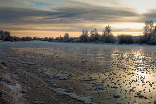 The river freezes over under the rising sun at the rural Fin... via Jukka Heinovirta