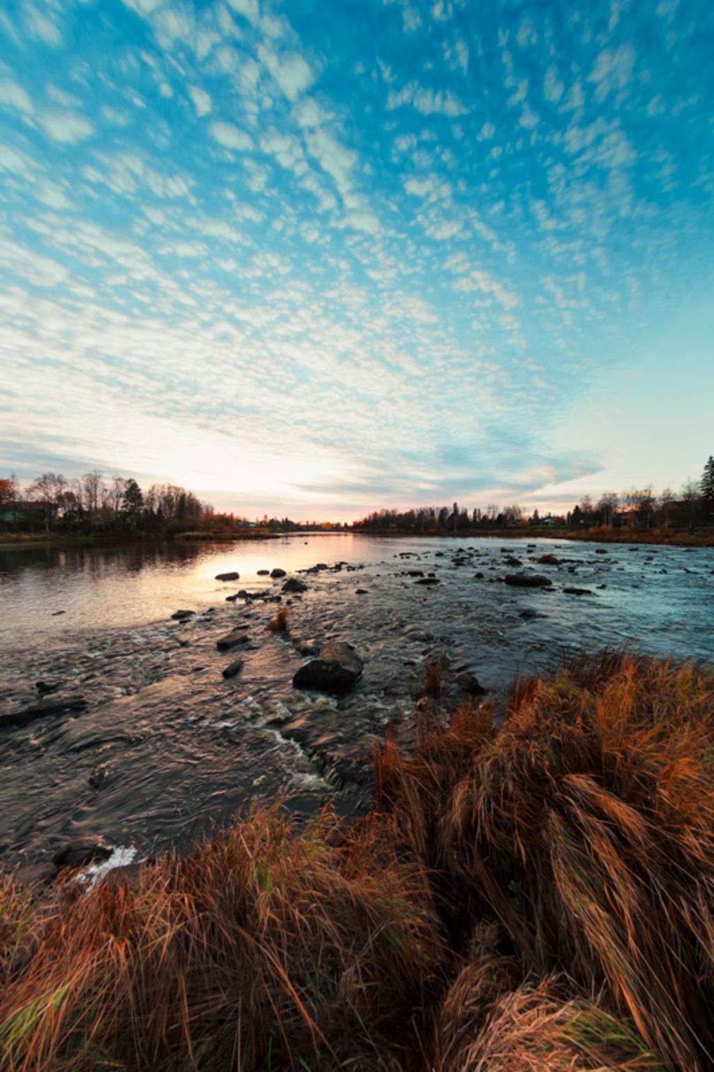 The sun sets beautifully behind the river bend in the autumn... via Jukka Heinovirta