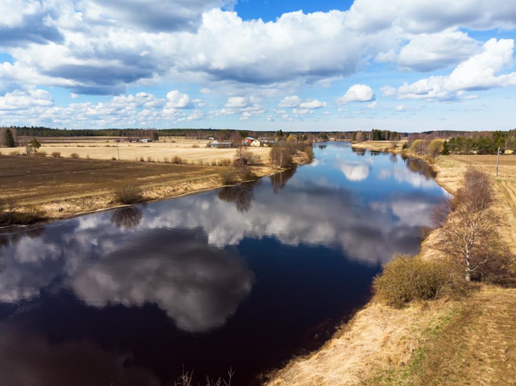 The beautiful clouds reflect on the still water of the river... via Jukka Heinovirta