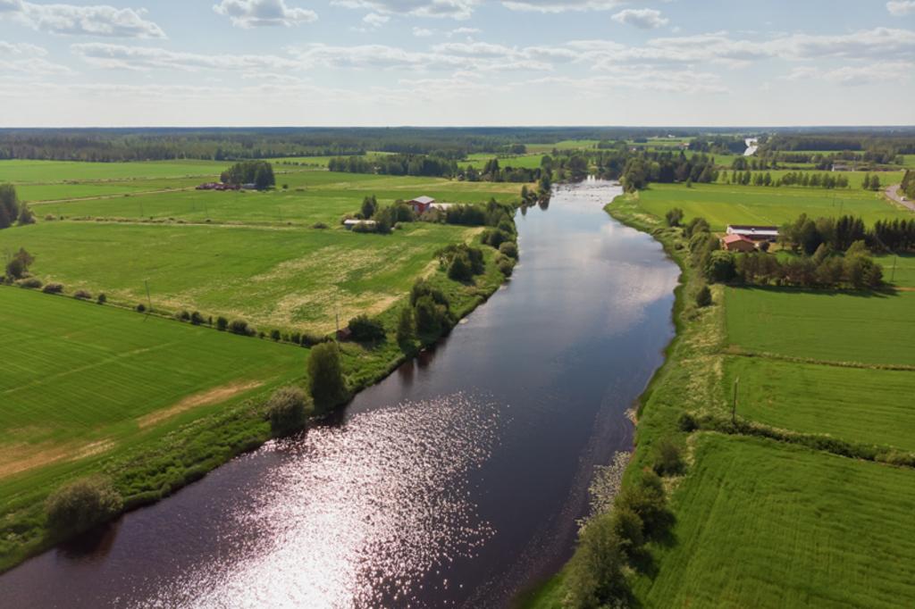 The river runs through the green fields of the rural Finland... via Jukka Heinovirta