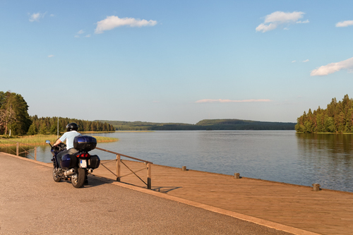 A man on a motorbike by a piear in a beautiful lakeside land... via Jukka Heinovirta