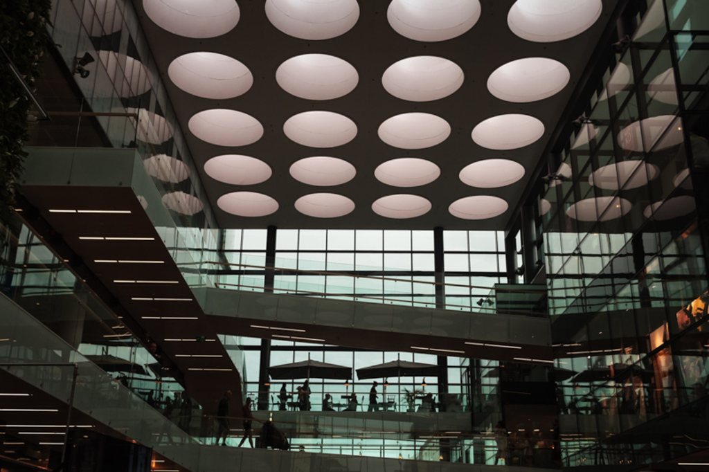 The giant round lamps light the interior of a shopping mall ... via Jukka Heinovirta