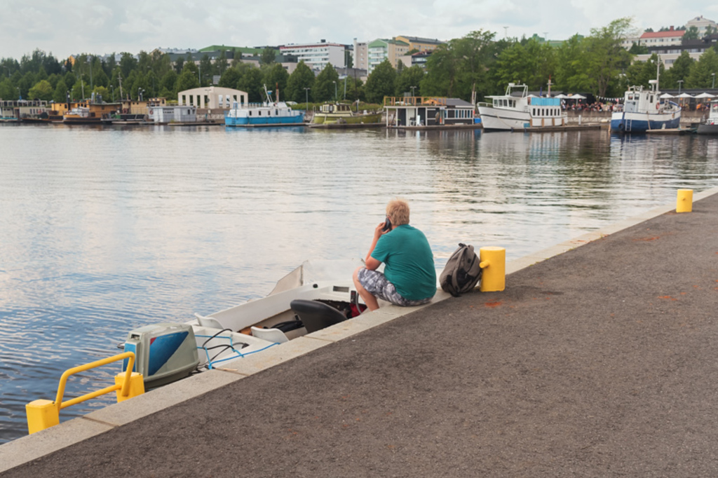 A lonely man is making a phone call sitting on a pier at Jyv... via Jukka Heinovirta