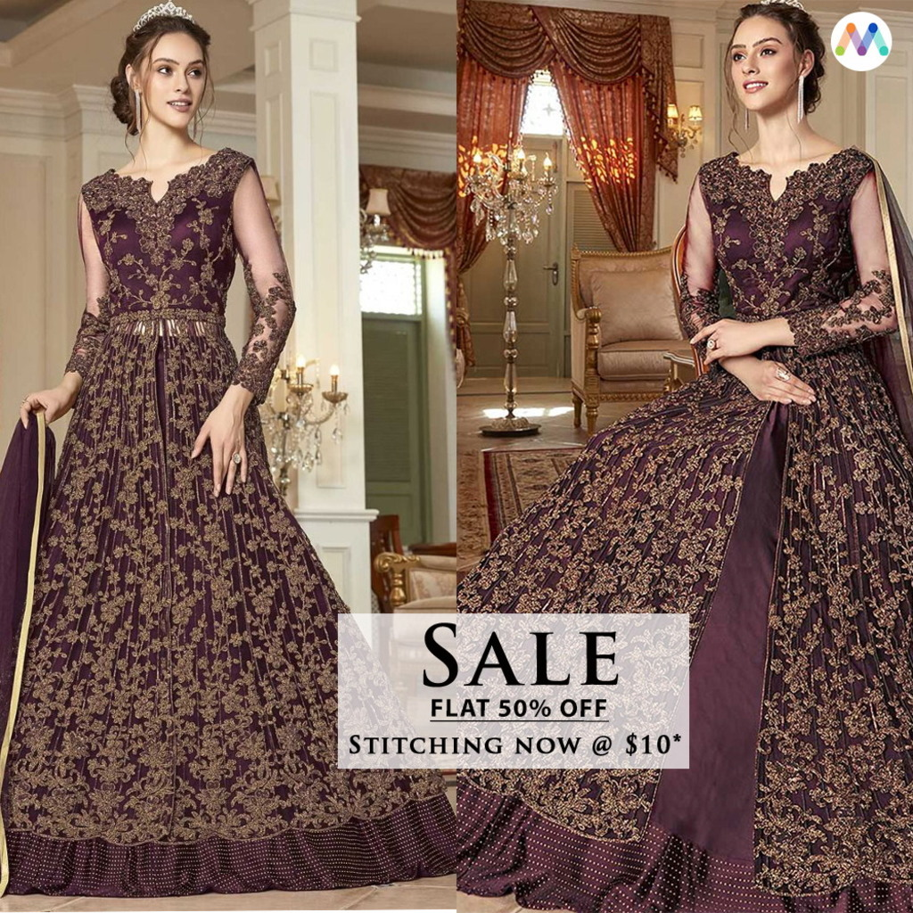 Drown yourself in this Pretty Wine Gown style suit enriched ... via Swapnil Shah