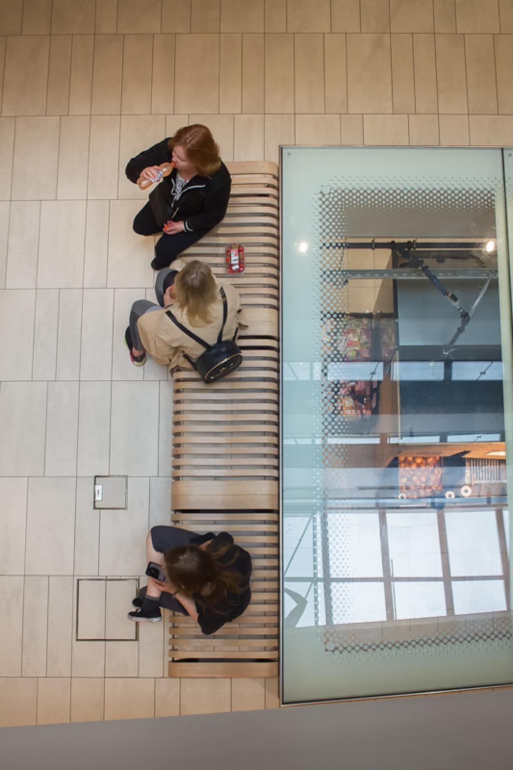 Above view of people having a break while shopping at the ma... via Jukka Heinovirta