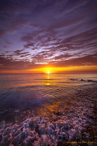 Sunrise on the shore of Lake Michigan in Wisconsin.                                                      Wisconsi... via Phil Koch