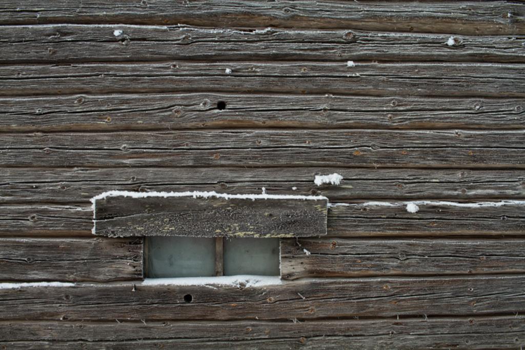 A tiny window on a wooden wall of an old barn house. The fro... via Jukka Heinovirta