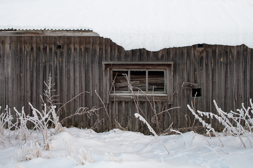 A three-part window frame on a wooden wall of an old barn ho... via Jukka Heinovirta