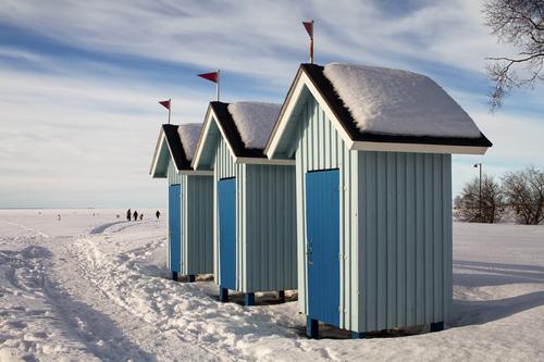 Three old beach huts stand empty on a beautiful winter day. ... via Jukka Heinovirta