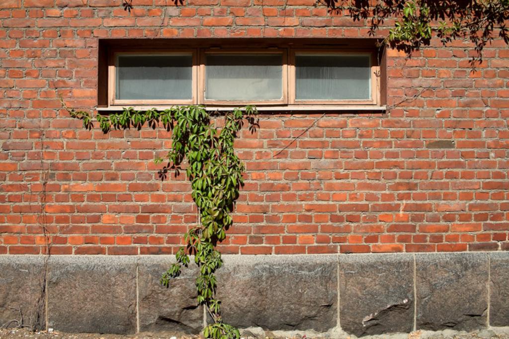 Three windows in an old brick wall at an industrial area. A ... via Jukka Heinovirta
