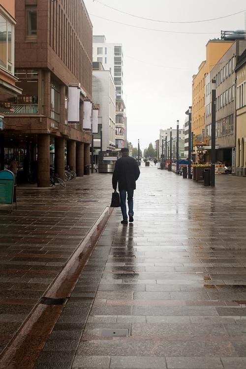 An old man is walking in the rain at Oulu, Finland. The spri... via Jukka Heinovirta