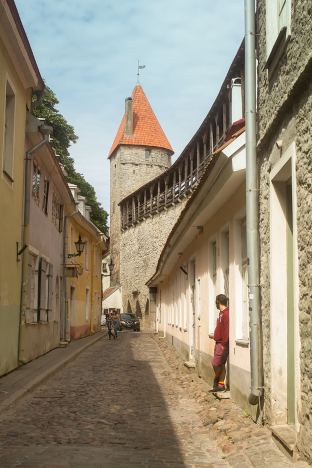 A young man is standing in the doorway at the old town of Ta... via Jukka Heinovirta
