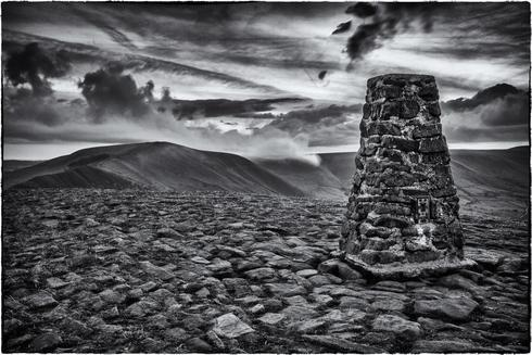 Mam Tor trig point, with the evening mist rolling in. via Dave
