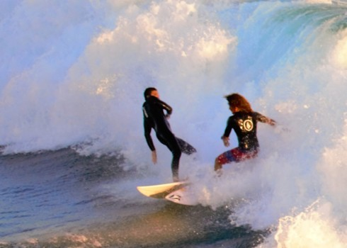 Surfers practicing in Huntington Beach, Ca. for the US Open ... via Steve La Motte