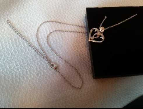 This heart shaped pendant is exactly as pictures show, very ... via michael jones