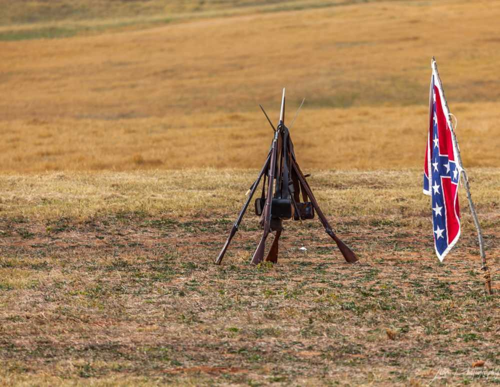 Rifles and Confederate Battle Flag in Hampton, Ga. via Liam Douglas - Professional Photographer