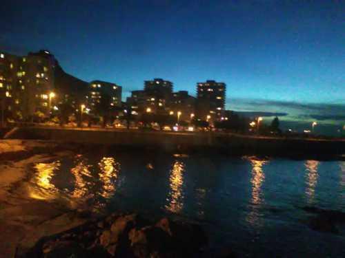 Beach and night lights. via Francoise Chauhan